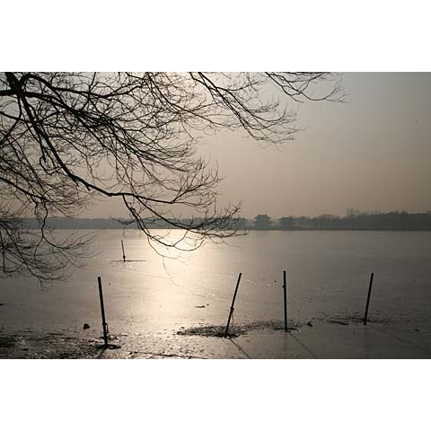 Beijing (China) and its region: view of the frozen lake  of the Summer Palace at dusk China photo Paul Maurer